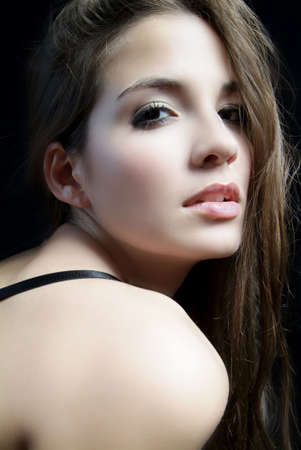 an erotic woman with long brown hair and shoulder Stock Photo