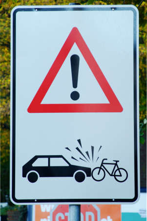 traffic sign with attention danger of accident car and cyclist photo
