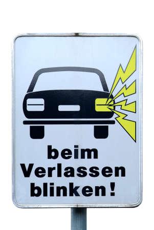 a white traffic sign with a car beim Verlassen blinken Stock Photo - 2173765
