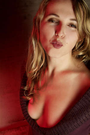 an attractive woman with sweater cut out far and kiss mouth photo