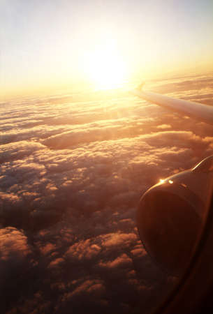 view from the airplane with sunrise and cloud