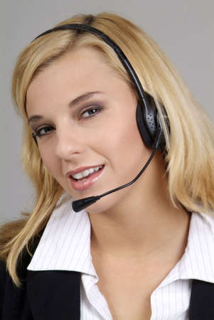 a friendly woman with blond hair and headphone photo