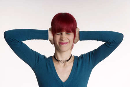 unfriendly: a woman with red hair and turned nose holds ear closed