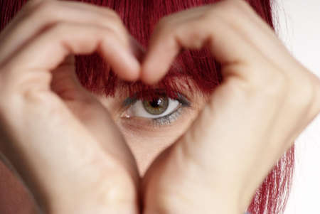 love proof: detail of a formed hand with heart and eye Stock Photo