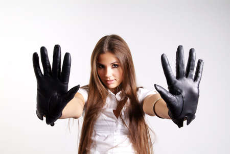 dactylology: pretty woman with long hair and black leather glove