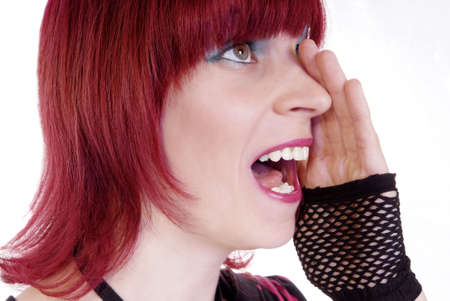 horrify: woman with red hair keeps ear closed Stock Photo