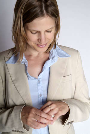 gorgios: a happy business woman with jacket and ring