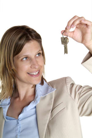 a young business woman with white suit and key photo