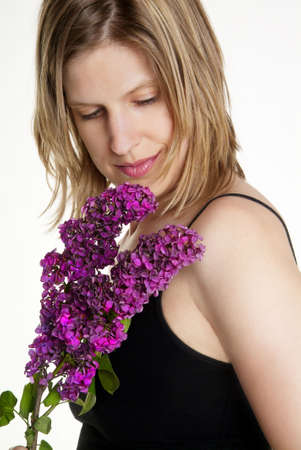 a young woman with top and pink syringa photo