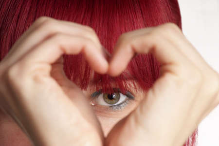 detail of a formed hand with heart and eye Stock Photo
