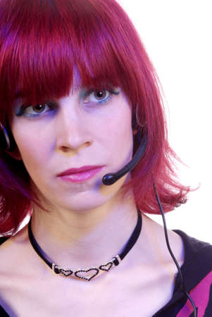 a friendly woman with red hair and headphone photo