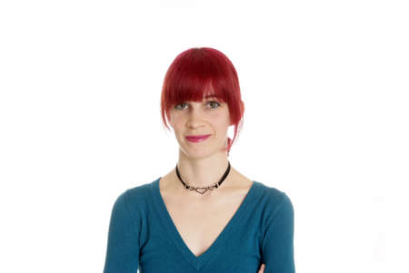 sneer: a friendly woman with red hair smiles