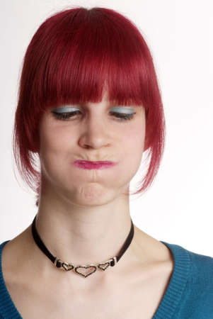 a young woman with red hair and blown up cheeks Stock Photo