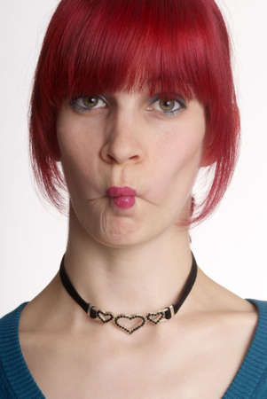 esplicito: una giovane donna con i capelli rossi e kissmouth Archivio Fotografico