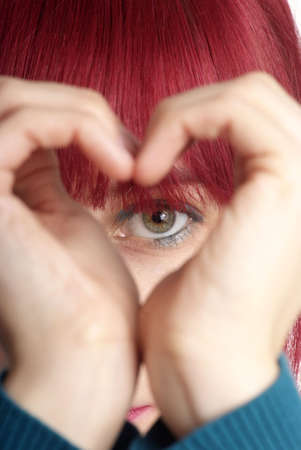 gape: detail of a formed hand with heart and eye Stock Photo