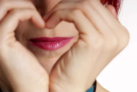 detail of a formed hand with heart and mouth Stock Photo - 2767870
