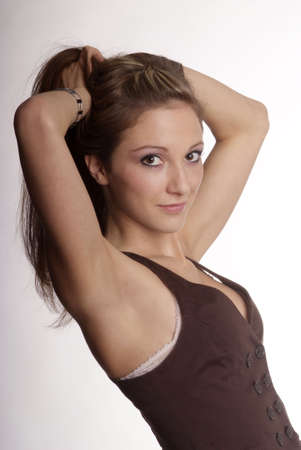 armpit hair: woman with brown hair and brown body warmer
