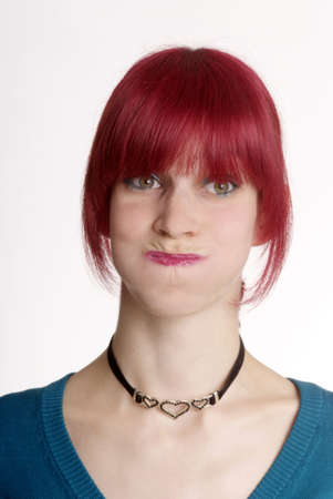 suffocate: a young woman with red hair and blown up cheek