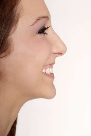 gorgios: detail of a woman with brown hair and smile Stock Photo