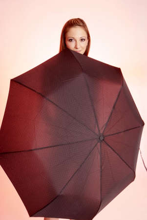 pretty woman with long brown hair and umbrella photo