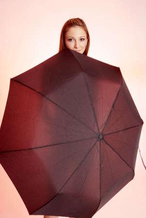 gorgios: pretty woman with long brown hair and umbrella