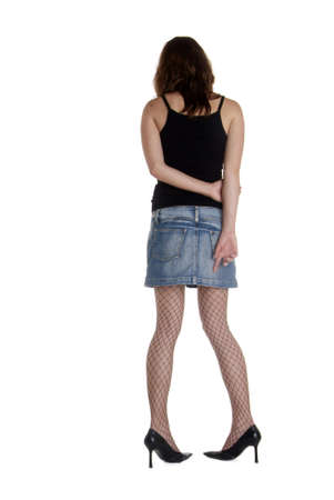 stilleto: the backside of a young woman in mini skirt