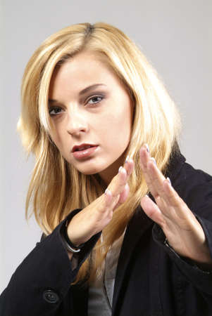 a cool blond woman with crossed hand