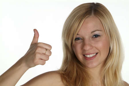 young blond woman hold thumb up
