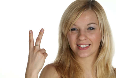 hold up: young blond woman hold two fingers up und smile Stock Photo