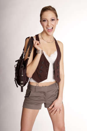a young woman hold her bag on shoulder