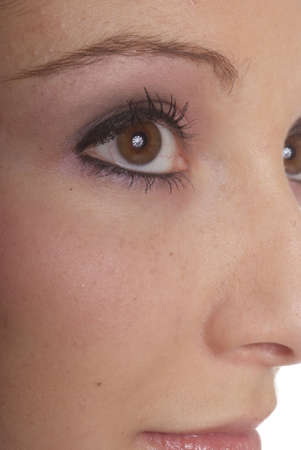 nearness: brown eye of a young woman with make-up Stock Photo