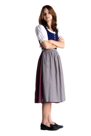 ryoung woman with dirndl stands with crossed arms Stock Photo