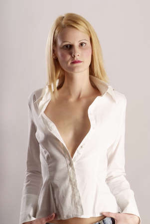 provocative young woman with long blond hair shows cleavage