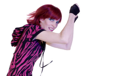 red-headed woman with pink shirt and fingerless gloves jumps