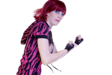 red-headed woman with pink shirt and fingerless gloves boxes