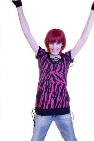 woman with red hair and pink shirt raises both arms