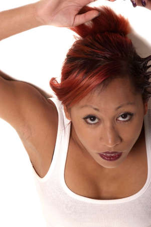 asian woman with red hair lying and looking up