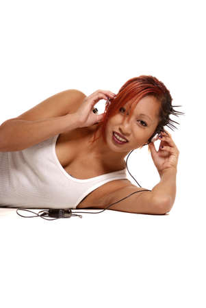 young asian woman lying on the floor with fingers on headphones