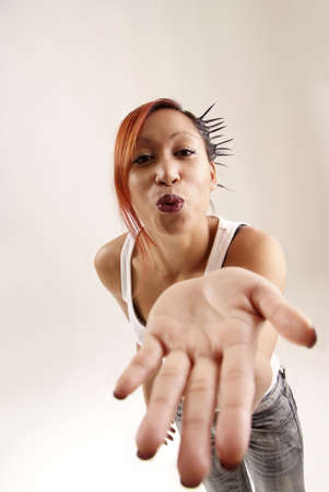 young friendly woman sending kiss with hand Stock Photo