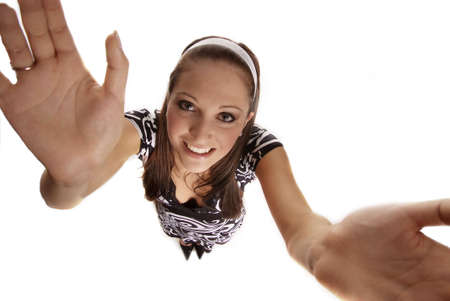 unbend: young friendly woman holding both hands up Stock Photo