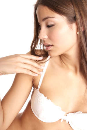young brownhaired woman with sexy white lingerie Stock Photo