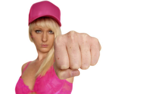 clench: young blonde woman in pink clench fist