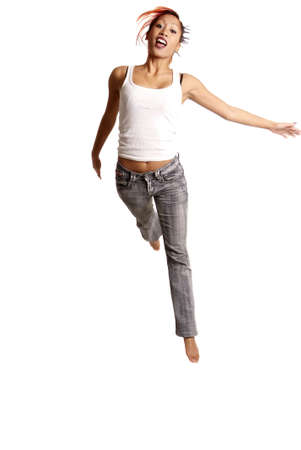 young woman jumps in front of white background Stock Photo