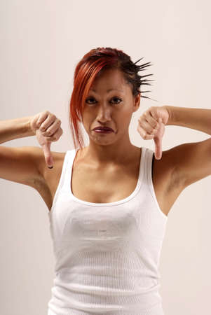 negatively: young woman with white top holding both thumbs down