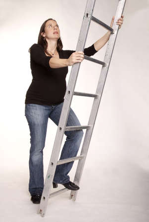adult pregnant woman climbing on career ladder