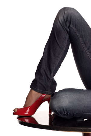 leg with red highheel on glossy table