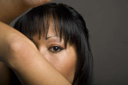 portrait of a young pretty asian woman hold arm up