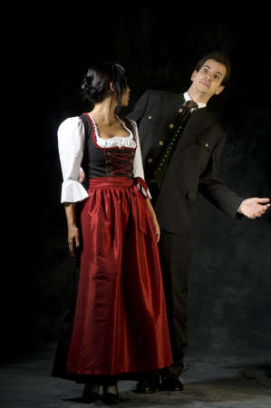 young woman and man in Dirndl and costume