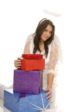 young dark-haired woman as angel with colorful gift Stock Photo