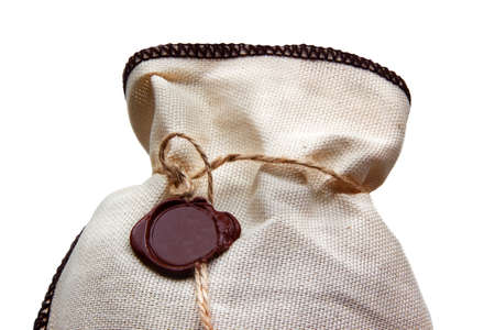 linen bag: Linen bag with brown wax seal isolated on white Stock Photo